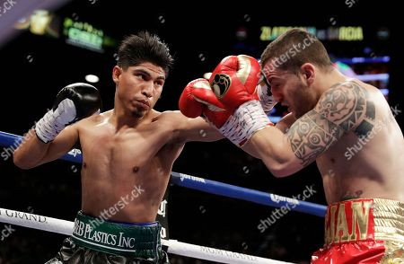 Mikey Garcia, left, hits Dejan Zlaticanin, of Montenegro, during a lightweight title boxing match, in Las Vegas