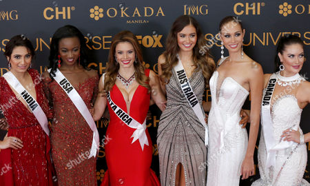 (L-R) Miss Universe candidates Roshmitha Harimurthy from India, Deshauna Barber from USA, Carolina Rodriguez Duran from Costa Rica, Caris Tiivel from Australia, Siera Bearchell from Canada, and Charlene Leslie from Aruba pose during the Miss Universe Red Carpet presentation on the eve of the pageant day in Pasay City, south of Manila, Philippines 29 January 2017. A total of 86 candidates are vying for the 65th Miss Universe crown, with the coronation event scheduled for 30 January.