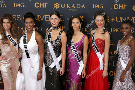 Stock Image of (L-R) Miss Universe candidates Keity Drennan from Panama, Monyque Brooks from Cayman Islands, Nuka Karalashvili from Georgia, Carolyn Carter from US Virgin Island, Zoey Ivory from The Netherlands, and Hawa Kamara from Sierra Leone pose during the Miss Universe Red Carpet presentation on the eve of the pageant day in Pasay City, south of Manila, Philippines 29 January 2017. A total of 86 candidates are vying for the 65th Miss Universe crown, with the coronation event scheduled for 30 January.