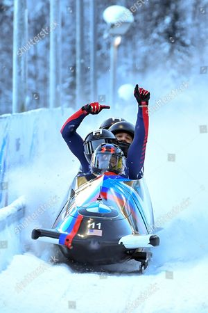 Steven Holcomb, Carlo Valdes, James Reed and Samuel McGuffie from the United States  celebrate in the finish area during the Four-Man race at the Bobsleigh World Cup on the artificial ice channel at Koenigssee near Berchtesgaden, Germany, 29 January 2017.