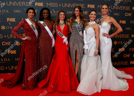 Roshmitha Harimurthy, Deshauna Barber, Carolina Duran, Caris Tiivel, Siera Bearchell, Charlene Leslie Miss Universe contestants pose on the red carpet on the eve of their coronation, at the Mall of Asia in suburban Pasay city south of Manila, Philippines. Eighty-six contestants are vying for the title to succeed Pia Wurtzbach from the Philippines. From left, Roshmitha Harimurthy of India, Deshauna Barber of the United States, Carolina Duran of Costa Rica, Caris Tiivel of Australia, Siera Bearchell of Canada and Charlene Leslie of Aruba