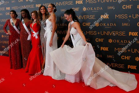 Roshmitha Harimurthy, Deshauna Barber, Carolina Duran, Caris Tiivel, Siera Bearchell, Charlene Leslie Miss Universe contestant Siera Bearchell, right, of Canada adjusts her gown as she poses with fellow contestants on the red carpet at the eve of their coronation, at the Mall of Asia in suburban Pasay city south of Manila, Philippines. Eighty-six contestants are vying for the title to succeed Pia Wurtzbach from the Philippines. From left, Roshmitha Harimurthy of India, Deshauna Barber of the United States, Carolina Duran of Costa Rica, Caris Tiivel of Australia and Charlene Leslie of Aruba