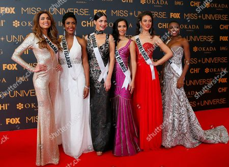 Keity Drennan, Monyque Brooks, Nuka Karalashvili, Carolyn Carter, Zoey Ivory, Hawa Kamara Miss Universe contestants pose on the red carpet on the eve of their coronation, at the Mall of Asia in suburban Pasay city south of Manila, Philippines. Eighty-six contestants are vying for the title to succeed Pia Wurtzbach from the Philippines. From left, Keity Drennan of Panama, Monyque Brooks of Cayman Islands, Nuka Karalashvili of Georgia, Carolyn Carter of U.S. Virgin Islands, Zoey Ivory of the Netherlands and Hawa Kamara of Sierra Leone