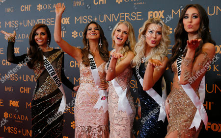 Brenda Jimenez, Valeria Piazza, Christina Waage, Ida Ovmar, Isabella Krzan Miss Universe contestants blow kisses to the media as they pose on the red carpet on the eve of their coronation, at the Mall of Asia in suburban Pasay city south of Manila, Philippines. Eighty-six conestants are vying for the title to succeed Pia Wurtzbach from the Philippines. From left, Brenda Jimenez of Puerto Rico, Valeria Piazza of Peru, Christina Waage of Norway, Ida Ovmar of Sweden, Isabella Krzan of Poland