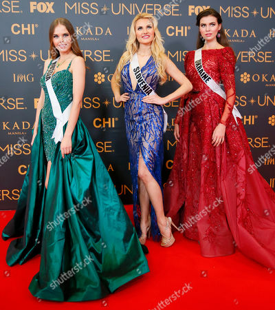 Yuliana Korolkova, Lucija Potocnik, Alena Spodynyuk Miss Universe contestants pose on the red carpet on the eve of their coronation, at the Mall of Asia in suburban Pasay city south of Manila, Philippines. Eighty-six conestants are vying for the title to succeed Pia Wurtzbach from the Philippines. From left, Yuliana Korolkova of Russia, Lucija Potocnik of Slovenia, Alena Spodynyuk of Ukraine