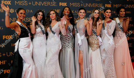 Chalita Suansane, Dijana Cvijetic, Teodora Dan, Jihan Dimack, Cheryl Chou, Zuzana Kollarova, Tansu Cakir, Jayathi de Silva Miss Universe contestants blow kisses to photographers as they pose on the red carpet on the eve of their coronation, at the Mall of Asia in suburban Pasay city south of Manila, Philippines. Eighty-six conestants are vying for the title to succeed Pia Wurtzbach from the Philippines. From left, Chalita Suansane of Thailand, Dijana Cvijetic of Switzerland, Teodora Dan of Romania, Jihan Dimack of Tanzania, Cheryl Chou of Singapore, Zuzana Kollarova of Slovak Republic, Tansu Cakir of Turkey, Jayathi de Silva of Sri Lanka