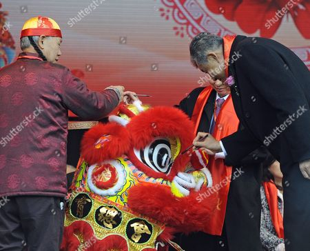 The Chinese Ambassador to London His  Excellency Mr. Liu Xiaoming dots the eye of the lion during the Chinese year of the Rooster celebrations at London's Trafalgar Square in London, Britain, 29 January 2017. The event is celebrating China's past and present with huge crowds.