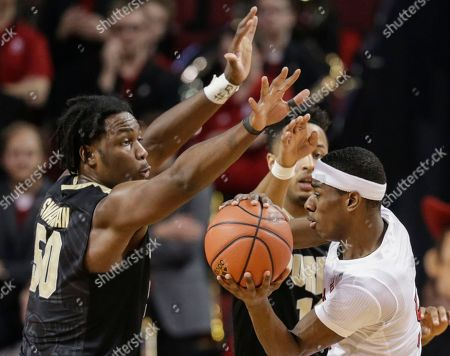 Vincent Edwards, Caleb Swanigan, Glynn Watson Jr Nebraska's Glynn Watson Jr., right, is guarded by Purdue's Caleb Swanigan (50) and Vincent Edwards, rear, during the first half of an NCAA college basketball game in Lincoln, Neb