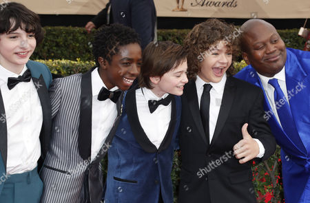 Finn Wolfhard (L), Caleb McLaughlin (2-L), Noah Schnapp (C), Gaten Matarazzo (2-R), and Tituss Burgess (R) arrive for the 23rd annual Screen Actors Guild Awards ceremony at the Shrine Exposition Center in Los Angeles, California, USA, 29 January 2017.
