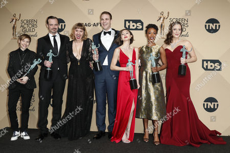 (L-R) Abigail Savage, James McMenamin, Emily Althaus, Alan Aisenberg, Kimiko Glenn, Samira Wiley and Julie Lake pose with the SAG Award for Outstanding Performance by an Ensemble in a Comedy Series award for 'Orange Is the New Black' during the 23rd annual Screen Actors Guild Awards ceremony at the Shrine Exposition Center in Los Angeles, California, USA, 29 January 2017.