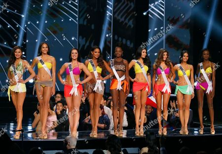 Maxine Medina, Raquel Pelissier, Sierra Bearchell, Andrea Tovar, Mary Were, Kristal Silva, Iris Mittenaere, Chalita Suansane, Deshauna Barber Miss Universe 2016 contestants pose after making it to the top 9 in the Miss Universe 2016 coronation, at the Mall of Asia in suburban Pasay city, south of Manila, Philippines. From left, Maxine Medina of the Philippines, Raquel Pelissier of Haiti, Sierra Bearchell of Canada, Andrea Tovar of Colombia, Mary Were of Kenya, Kristal Silva of Mexico, Iris Mittenaere of France, Chalita Suansane of Thailand and Deshauna Barber of the United States. Mittenaere was proclaimed the Miss Universe 2016