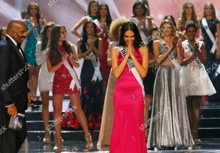 Chalita Suansane of Thailand greets the crowd the traditional Thai way after making it to the top 13 in the Miss Universe 2016 competition, at the Mall of Asia in suburban Pasay city? south of Manila, Philippines. Iris Mittenaere of France was crowned the Miss Universe