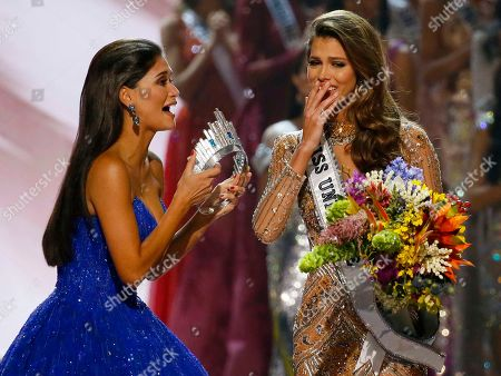 Pia Wurtzbach, Iris Mittenaere Miss Universe 2015 Pia Wurtzbach, left, of the Philippines rushes to crown Miss France Iris Mittenaere as the Miss Universe 2016 in coronation, at the Mall of Asia in suburban Pasay city, south of Manila, Philippines