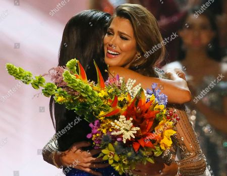 Ris Mittenaere, Pia Wurtzbach Miss Universe 2016 Iris Mittenaere, right, of France is hugged by Miss Universe 2015 Pia Wurtzbach following coronation, at the Mall of Asia in suburban Pasay city, south of Manila, Philippines