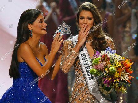 Pia Wurtzbach, Iris Mittenaere Miss Universe 2015 Pia Wurtzbach, left, prepares to crown Iris Mittenaere of France shortly after being proclaimed the Miss Universe 2016 in coronation, at the Mall of Asia in suburban Pasay city, south of Manila, Philippines