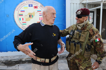 French Actor Philippe Leroy (l) Speaks with an Italian Soldier During His Visit in Herat Afghanistan 11 April 2011 Leroy a Former Partrooper in Indochina and Algeria Said He is in the Country to Express 'Solidarity' Afghanistan Herat