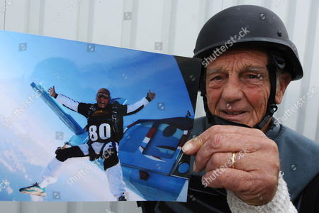 French Actor Philippe Leroy Shows a Picture of His Parachute Jump on His 80th Birthday During His Visit in Herat Afghanistan 11 April 2011 Leroy a Former Partrooper in Indochina and Algeria Said He is in the Country to Express 'Solidarity' Afghanistan Herat