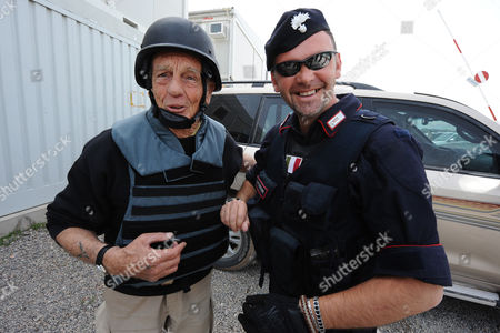 French Actor Philippe Leroy (l) Poses For a Photograph with an Italian Carabiniere-soldier During His Visit in Herat Afghanistan 11 April 2011 Leroy a Former Partrooper in Indochina and Algeria Said He is in the Country to Express 'Solidarity' Afghanistan Herat