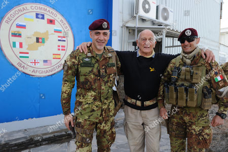 French Actor Philippe Leroy (c) Poses For a Photograph with Two Italian Soldiers During His Visit in Herat Afghanistan 11 April 2011 Leroy a Former Partrooper in Indochina and Algeria Said He is in the Country to Express 'Solidarity' Afghanistan Herat