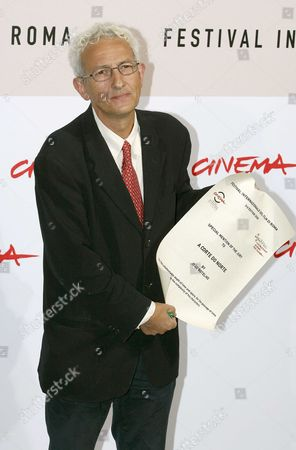 """Director Joao Botelho shows the special mention for his film """"A corte do norte"""" (Northern land),"""