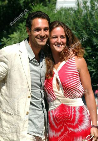 Italian Actor Raoul Bova (l) Poses with His Wife Chiara Giordano at the Wet Dock of Venice' S Lido on Wednesday 03 September 2003 Bova who is Regarded As the Most Beautiful Italian Actor and a Few Years Ago Posed Totally Naked For the Italy' S Most Sold Calendar Depicting a Nude Male and Played in an International Advertising Spot with Rockstar Madonna Will Be Given Later Today the 'Diamonds at the Cinema Award' at the 60th International Exhibition of Cinema Art Better Known As Venice Film Festival in the Next Days Raoul Bova Will Leave For the United States where He Will Attend the World Premiere of His First International Film 'Under the Tuscan Sun' Taken From the Homonymous Best Seller by Us Writer Frances Meyes Directed by Audrey Wells and Co-starred by Diane Lane Which is Scheduled in Los Angeles on 20 September Epa Photo/ansa/claudio Onorati// Italy Venice, Ita
