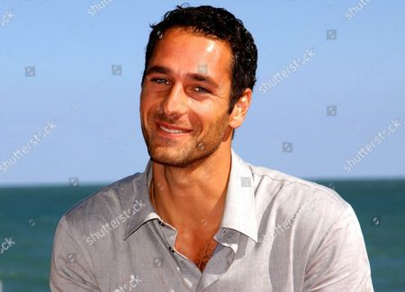 Italian Actor Raoul Bova Smiles For the Photographers at the Martini Terrace of Venice' S Lido on Wednesday 03 September 2003 Bova who is Regarded As the Most Beautiful Italian Actor and a Few Years Ago Posed Totally Naked For the Italy' S Most Sold Calendar Depicting a Nude Male and Played in an International Advertising Spot with Rockstar Madonna Will Be Given Later Today the 'Diamonds at the Cinema Award' at the 60th International Exhibition of Cinema Art Better Known As Venice Film Festival in the Next Days Raoul Bova Will Leave For the United States where He Will Attend the World Premiere of His First International Film 'Under the Tuscan Sun' Taken From the Homonymous Best Seller by Us Writer Frances Meyes Directed by Audrey Wells and Co-starred by Diane Lane Which is Scheduled in Los Angeles on 20 September Epa Photo/ansa/claudio Onorati// Italy Venice