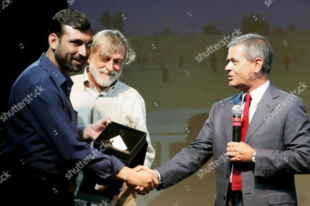 (l-r) Rahmatullah Hanefi an Afghan Employee of an Italian Aid Group who was Detained by the Afghan Government For Three Months Gino Strada Founder of the Aid Group Emergency and Ezio Mauro Director of Italian Newspaper 'La Repubblica' During the Party in Farnese Square in Rome Italy on 09 July 2007 Hanefi Had Been Involved in Negotiations Over the Release of Italian Journalist Daniele Mastrogiacomo who was Kidnapped by the Taliban in March 2007 He Had Been Held Over Accusations That He Had Helped with the Abduction But was Cleared of All Accusations and Released in June 2007 Italy Rome