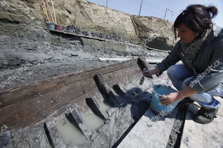 An Archeologist is Pictured at the Ostia Antica Archaeological Site in Rome Italy where an Ancient Roman Ship Has Been Discovered on 28 April 2011 an Ancient Ship Has Emerged From the Ground at the Imperial Roman Port of Ostia in a Find Culture Minister Giancarlo Galan Said 'Gives You Goose Bumps' an 11-metre Section of One of the Ship's Sides Has So Far Been Discovered Archaeologists Said They and Galan Said the Discovery Would Make Experts Think Anew About the Exact Location of the Port where the Roman Empire's Biggest Fleet was Stationed and Through Which Goods Travelled to and From the Imperial Capital Italy Rome