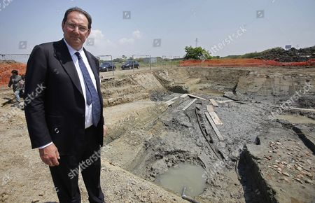 Italian Culture Minister Giancarlo Galan Stands at the Ostia Antica Archaeological Site in Rome where an Ancient Roman Ship Has Been Discovered on 28 April 2011 an Ancient Ship Has Emerged From the Ground at the Imperial Roman Port of Ostia in a Find Culture Minister Giancarlo Galan Said 'Gives You Goose Bumps' an 11-metre Section of One of the Ship's Sides Has So Far Been Discovered Archaeologists Said They and Galan Said the Discovery Would Make Experts Think Anew About the Exact Location of the Port where the Roman Empire's Biggest Fleet was Stationed and Through Which Goods Travelled to and From the Imperial Capital Italy Rome