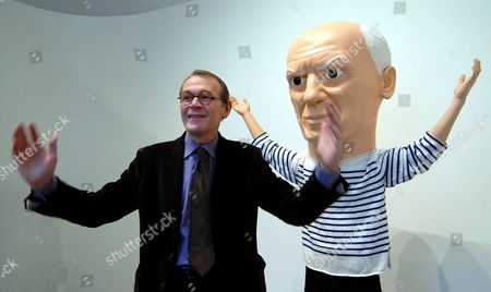 Chairman of Palazzo Grassi Showrooms Jean Jacques Aillagon Gestures Next to the Homage to Pablo Picasso by Italian Sculptor Maurizio Cattelan Exposed Thursday 09 November 2006 at Palazzo Grassi in Venice at Picasso's Exhibition Titled 'La Joie De Vivre' Italy Venice