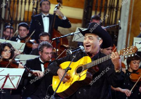 Eliades Ochoa Guitarist and Frontman of Cuban Band 'Buena Vista Social Club' Plays the Guitar During a Traditional Concert For Epiphany at Santa Maria La Nova Church in Naples Sunday 03 January 2004 Italy Naples