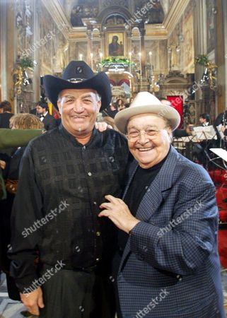 Eliades Ochoa (l) Guitarist and Frontman of the Cuban Band 'Buena Vista Social Club' and Neapolitan Singer Aurelio Fierro (r) Smile During a Traditional Concert For Epiphany at Santa Maria La Nova Church in Naples Sunday 03 January 2004 Italy Naples