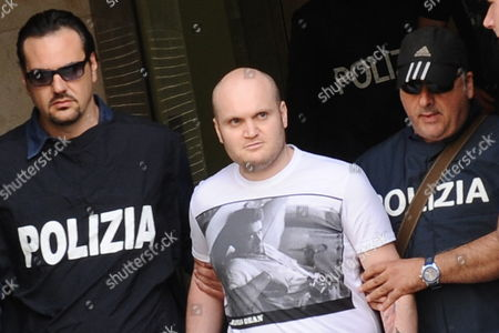 Carmine Amato (c) Aged 30 One of the 100 Most Wanted Italian Criminals is Escorted by Italian Police Officers As They Leave the Police Headquarters in Naples Italy on 08 June 2011 Reports State That Carmine Amato Alleged to Be the Regent of the Amato-pagano Clan (an Ex-branch of the Lauro Clan) and to Control Naples Northern Outskirts was Arrested Hiding in a Small Villa in Camaldoli on the Hills Overlooking the Town Having Been a Fugative Since 2009 Regent of the Camorra Clan Amato-pagani out of the Police Headquarters in Naples Today 8 June 2011 Amato was in 2009 S Added to the List of the Hundred Most Dangerous Fugitives is Accused of Mafia-like Criminal Organization Drug Trafficking and Murder Italy Naples