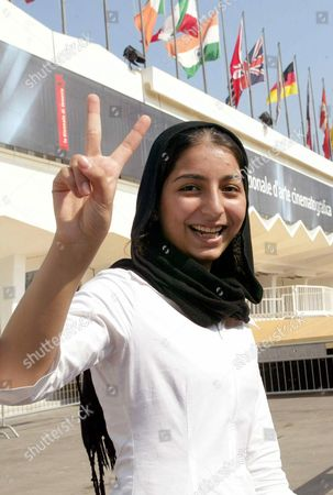Young Iranian Director Hana Makhmalbaf 15 Shows Flashes a 'V' Sign 28 August 2003 in Front of the Cinema Palace in Venice Ahead the Presentation of Her Movie 'Joy of Madness' That Will Be in Screened Today in the Section 'Critics International Week' the 15-year-old Iranian Director was not Allowed to See the Press Screening of Her Own Film at the Venice Film Festival Because She was Deemed Too Young Reports Said Thursday Hana Makhmalbaf was Prevented by Theatre Attendants From Entering the Auditorium where Her Film 'Joy of Madness' was Playing Wednesday Evening an Exception to the Age Restriction Will Be Made For the Official Premiere on Thursday Reports Said Epa Photo/ansa/claudio Onorati// Italy Venice
