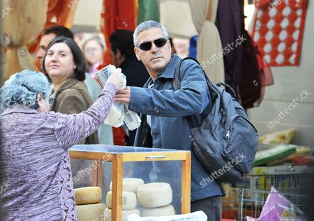 Stock Photo of Us Actor George Clooney at the Market in Sulmona Italy 07 October 2009 Clooney is in Town For the Shooting of His New Movie 'The American' the Film by Dutch Director Anton Corbijn is Based on the Novel 'A Very Private Gentleman' by British Author Martin Booth the Cast Includes George Clooney Violante Placido Paolo Bonacelli and Dutch Tekla Reuten Filming was Set in the Market 07 October and It Will Move to the Alleyways on 08 October Italy Sulmona