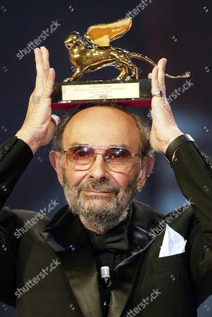 Stock Picture of Us Film Director Stanley Donen Poses with the Golden Lion For Lifetime Achievement Award That He was Awarded with at the 61st International Exhibition of Cinema Art Better Known As Venice Film Festival on Saturday 11 September 2004 Italy Venice