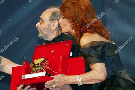 Stock Photo of Italian Cinema Star Sophia Loren (r) Joins Us Movie Director Stanley Donen who Holds the Golden Lion For Lifetime Achievement with Which He was Awarded at the 61st International Exhibition of Cinema Art Better Known As Venice Film Festival on Saturday 11 September 2004 Italy Venice