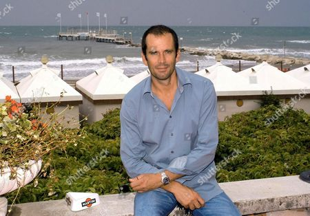 French Actor Christian Vadim Poses For a Photo August 29 2003 Seated on the Martini Terrace of the Venitian Lido Vadim is in Venice to Promote His Movie 'Une Place Parmi Les Vivants' Directed by Raoul Ruiz Yesterday on Show in the 'Upstream' Section Epa Photo/ansa/caludio Onorati// Italy Venice