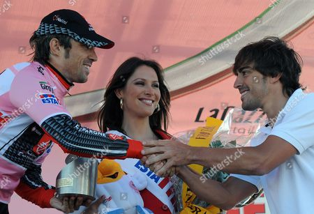 Spain's David Duran Arroyo (l) Wearing the Pink Jersey of Overall Leader of the Race is Congratulated by His Fellow-countryman Fernando Alonso on the Podium After the 16th Stage of the Giro D'italia Tour of Italy Cycling Race an Individual Time Trial From San Vigilio Marebbe to Plan De Corones Italy on 25 May 2010 Italy Plan De Corones (bolzano)