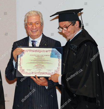 Italian Industrial Designer Giorgetto Giugiaro (l) Receiving an Honorary Degree in Architecture From the Turin Polytechnic Dean Francesco Profumo (r) in Turin Italy on 11 November 2010 Italy Torino