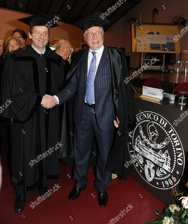Italian Industrial Designer Giorgetto Giugiaro (r) Receiving an Honorary Degree in Architecture From the Turin Polytechnic Dean Francesco Profumo (l) in Turin Italy on 11 November 2010 Italy Torino