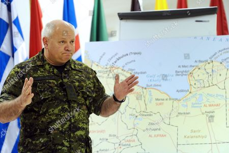 Stock Picture of Canadian Lieutenant General Charles Bouchard Commander of the Nato Military Operations in Libya Gestures During a Press Conference at the Nato's Southern Europe Headquarters in Naples Italy 26 April 2011 Forces Loyal to Libyan Leader Muammar Gaddafi Have Shelled Rebels Inside Several Western Cities As Nato Launched Fresh Strikes Aimed at Weakening Gaddafis Troops Italy Naples