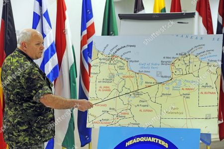Stock Image of Canadian Lieutenant General Charles Bouchard Commander of the Nato Military Operations in Libya Points at a Map During a Press Conference at the Nato's Southern Europe Headquarters in Naples Italy 26 April 2011 Forces Loyal to Libyan Leader Muammar Gaddafi Have Shelled Rebels Inside Several Western Cities As Nato Launched Fresh Strikes Aimed at Weakening Gaddafis Troops Italy Naples