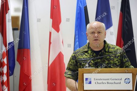 Canadian Lieutenant General Charles Bouchard Commander of the Nato Military Operations in Libya Holds a Press Conference at the Nato's Southern Europe Headquarters in Naples Italy 26 April 2011 Forces Loyal to Libyan Leader Muammar Gaddafi Have Shelled Rebels Inside Several Western Cities As Nato Launched Fresh Strikes Aimed at Weakening Gaddafis Troops Italy Naples