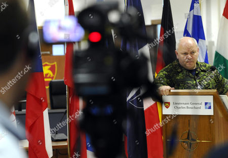 Canadian Lieutenant General Charles Bouchard (r) During a Press Conference at Nato's Bagnoli Base in Naples Italy on 31 March 2011 on His First Day As Commander of the Libyan Mission Charles Bouchard Said Since Nato Assumed Control at 0600 Gmt on 31 March 2011 Its Aircraft Had Conducted More Than 90 Flights and the Alliance Had More Than 100 Fighter Jets and Support Aircraft at Its Disposal As Well As a Dozen Frigates to Control the Mediterranean Italy Naples