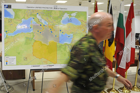 Canadian Lieutenant General Charles Bouchard Leaves a Press Conference at Nato's Bagnoli Base in Naples Italy on 31 March 2011 on His First Day As Commander of the Libyan Mission Charles Bouchard Said Since Nato Assumed Control at 0600 Gmt on 31 March 2011 Its Aircraft Had Conducted More Than 90 Flights and the Alliance Had More Than 100 Fighter Jets and Support Aircraft at Its Disposal As Well As a Dozen Frigates to Control the Mediterranean Italy Naples