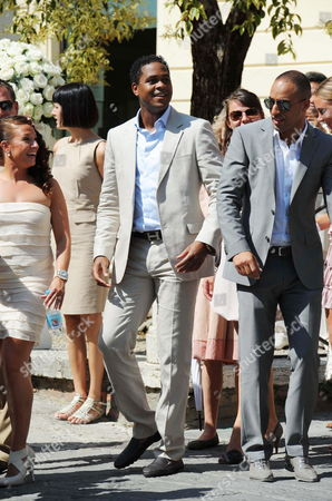 Dutch Former Soccer Player Patrick Kluivert (c) Stands at the End of the Wedding Ceremony of Dutch Midfielder Wesley Sneijder of Inter Milan with Compatriot Yolanthe Cabau Van Kasbergen in the Santi Giusto E Clemente's Church in Castelnuovo Berardenga in the Province of Siena Italym on 17 July 2010 Italy Castelnuovo Berardenga