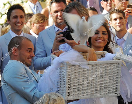 Dutch Midfielder Wesley Sneijder of Inter Milan and His Bride Dutch Actress and Model Yolanthe Cabau Van Kasbergen at the End of Their Wedding Ceremony in the Santi Giusto E Clemente's Church in Castelnuovo Berardenga in the Province of Siena Italy on 17 July 2010 Italy Castelnuovo Berardenga
