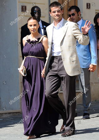 Romanian Soccer Player Christian Chivu Defender of Inter Milan and of Romania's National Team and His Wife at the End of the Wedding Ceremony of Dutch Midfielder Wesley Sneijder of Inter Milan with Compatriot Yolanthe Cabau Van Kasbergen in the Santi Giusto E Clemente's Church in Castelnuovo Berardenga in the Province of Siena Italym on 17 July 2010 Italy Castelnuovo Berardenga