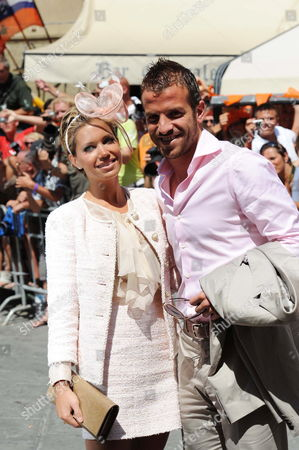 Dutch Soccer Player Rafael Van Der Vaart Midfielder of Real Madrid and of the Netherlands's National Team and His Wife at the End of the Wedding Ceremony of Dutch Midfielder Wesley Sneijder of Inter Milan with Compatriot Yolanthe Cabau Van Kasbergen in the Santi Giusto E Clemente's Church in Castelnuovo Berardenga in the Province of Siena Italym on 17 July 2010 Italy Castelnuovo Berardenga